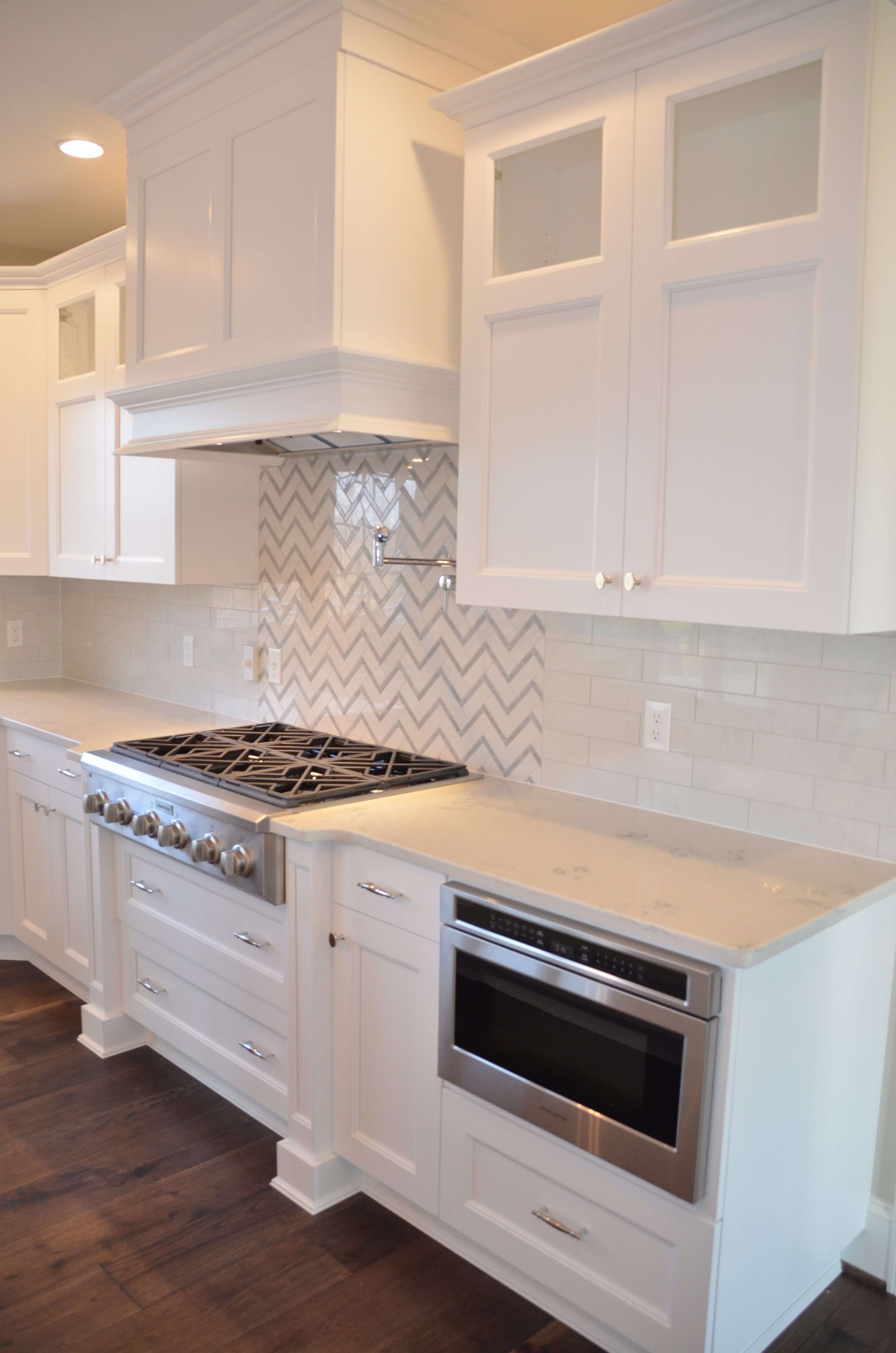 Custom White Kitchen With Quartz Countertops
